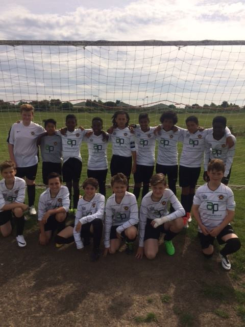 The U13s in their lucky white change kit.