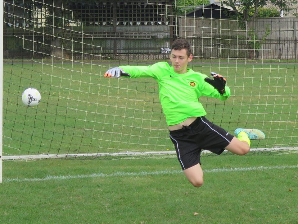 The U15s Goal keeper in flight.