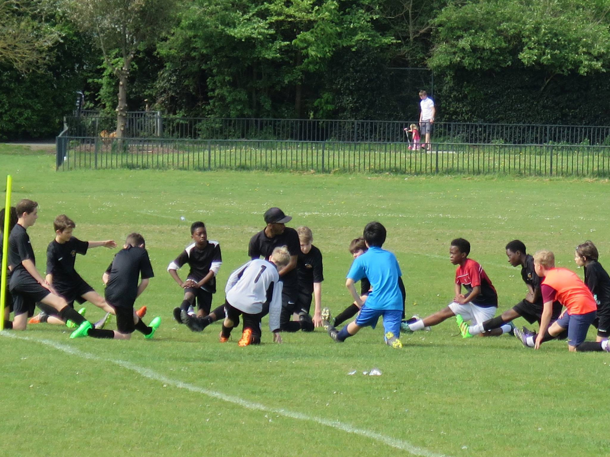 Darrius showing the U13s about stretches