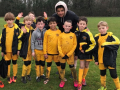 Peteborough Striker Lee Angol supports the Under 9s