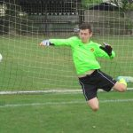 The U15s Goal keeper in flight.